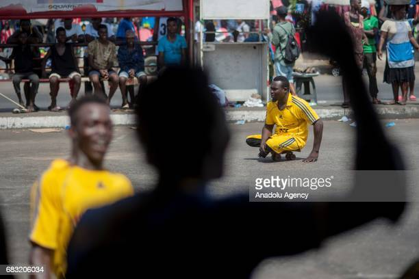 Ghanaian teenagers who contracted polio and lost their walking ability play soccer in Tudu district of Accra Ghana on May 14 2017 Teenagers who...