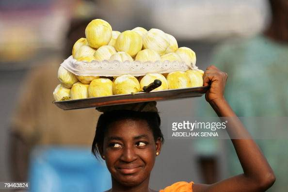 A Ghanaian vendor sells fruits in city center of Accra 01 Feburary 2008 during the African Cup of Nations football championship AFP PHOTO / ABDELHAK...