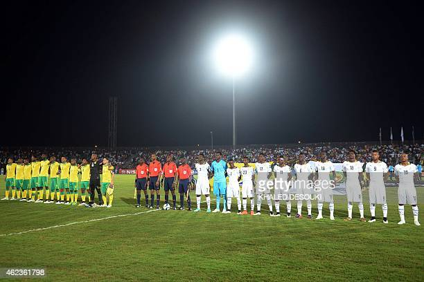 Ghana's and South Africa's players listen to their national anthems ahead of the 2015 African Cup of Nations group C football match between South...