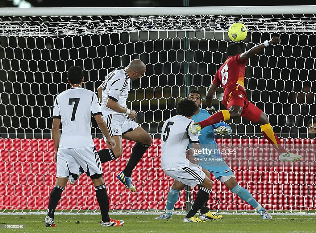 Ghana's Anthony Annan (R) tries to score against Egypt during their friendly football match in Abu Dhabi on January 10, 2013.