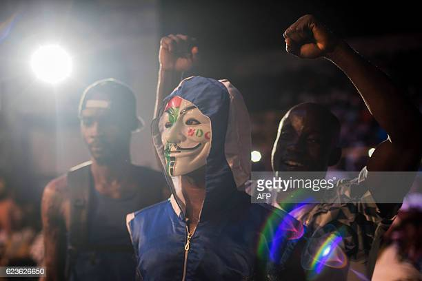 Ghana's Benjamin Lamptey wearing a Guy Fawkes mask prepares to get into the ring to fight for the National Lightweight belt against Ghana's Sheriff...