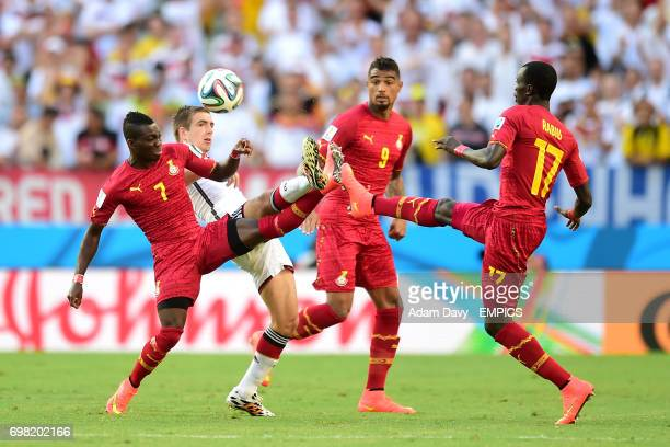 Ghana's Christian Atsu Kevin Prince Boateng and Mohammed Rabiu combine to deny Germany's Philipp Lahm