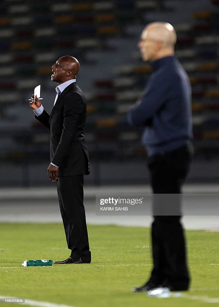 Ghana's coach James Kwasi Appiah (L) shouts to his team as Egypt's coach Bob Bradley (R) watches the game as their teams play a friendly football match in Abu Dhabi on January 10, 2013.