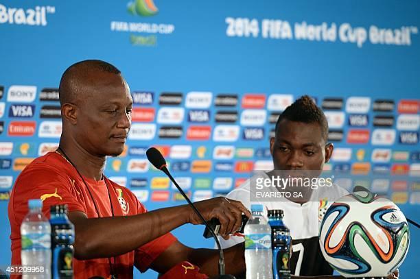 Ghana's coach Kwesi Appiah and midfielder Christian Atsu Twasan attend a press conference at the Mane Garrincha National Stadium in Brasilia on June...