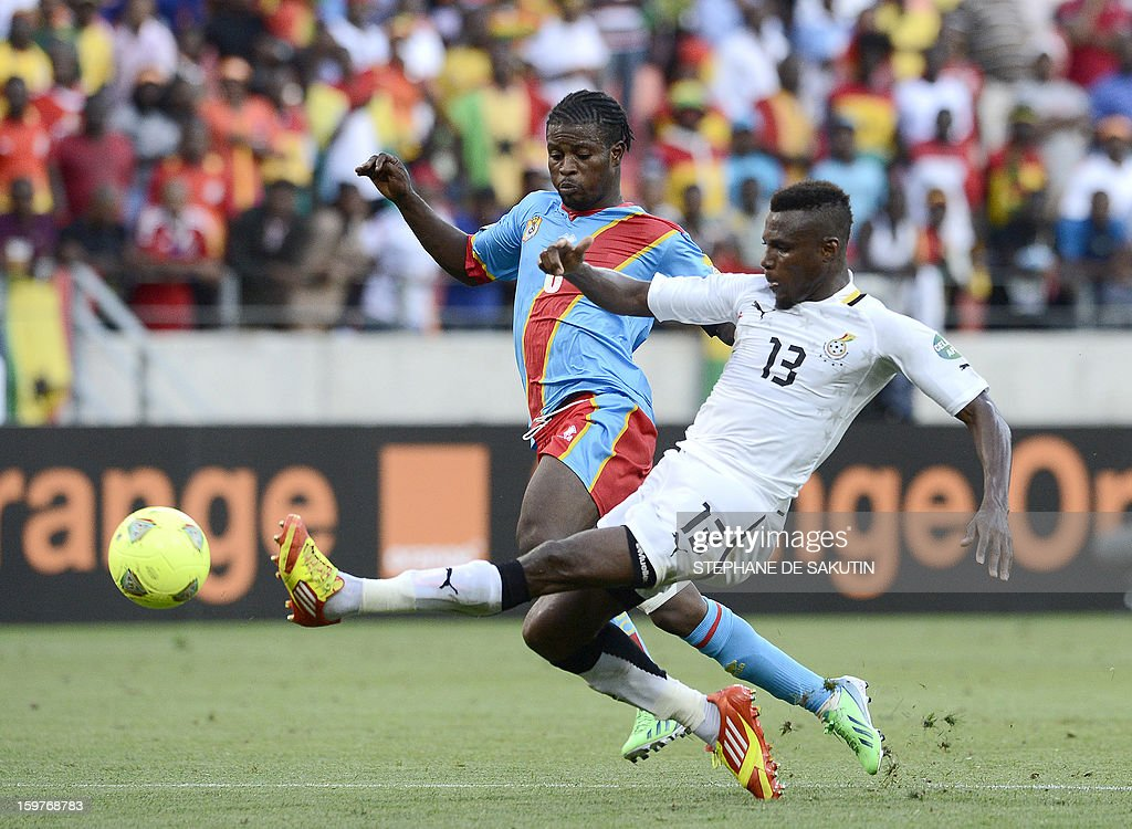 Ghana's defender Jerry Akaminko (R) vies for the ball with Democratic Republic of Congo's midfielder Tresor Mputu during their 2013 African Cup of Nations football match at the Nelson Mandela Bay Stadium in Port Elizabeth on January 20, 2013.