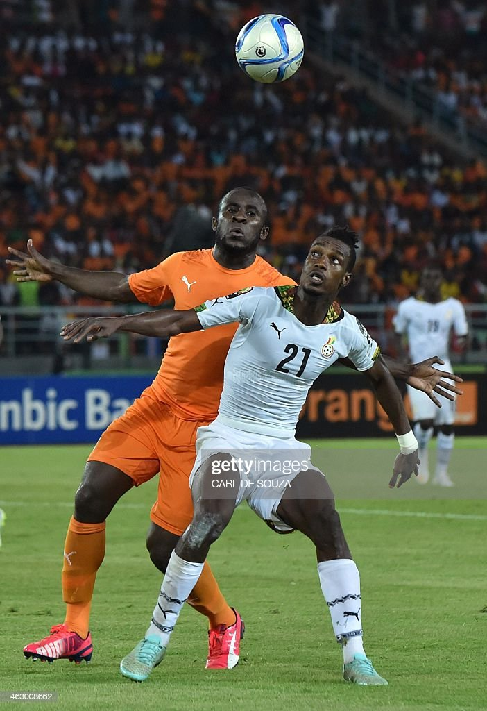 Ghana's defender <a gi-track='captionPersonalityLinkClicked' href=/galleries/search?phrase=John+Boye&family=editorial&specificpeople=7190220 ng-click='$event.stopPropagation()'>John Boye</a> (R) challenges Ivory Coast's forward <a gi-track='captionPersonalityLinkClicked' href=/galleries/search?phrase=Seydou+Doumbia&family=editorial&specificpeople=5546505 ng-click='$event.stopPropagation()'>Seydou Doumbia</a> during the 2015 African Cup of Nations final football match between Ivory Coast and Ghana in Bata on February 8, 2015. Ivory Coast won 9-8 on penalties after the final ended 0-0 following extra time. AFP PHOTO / CARL DE SOUZA