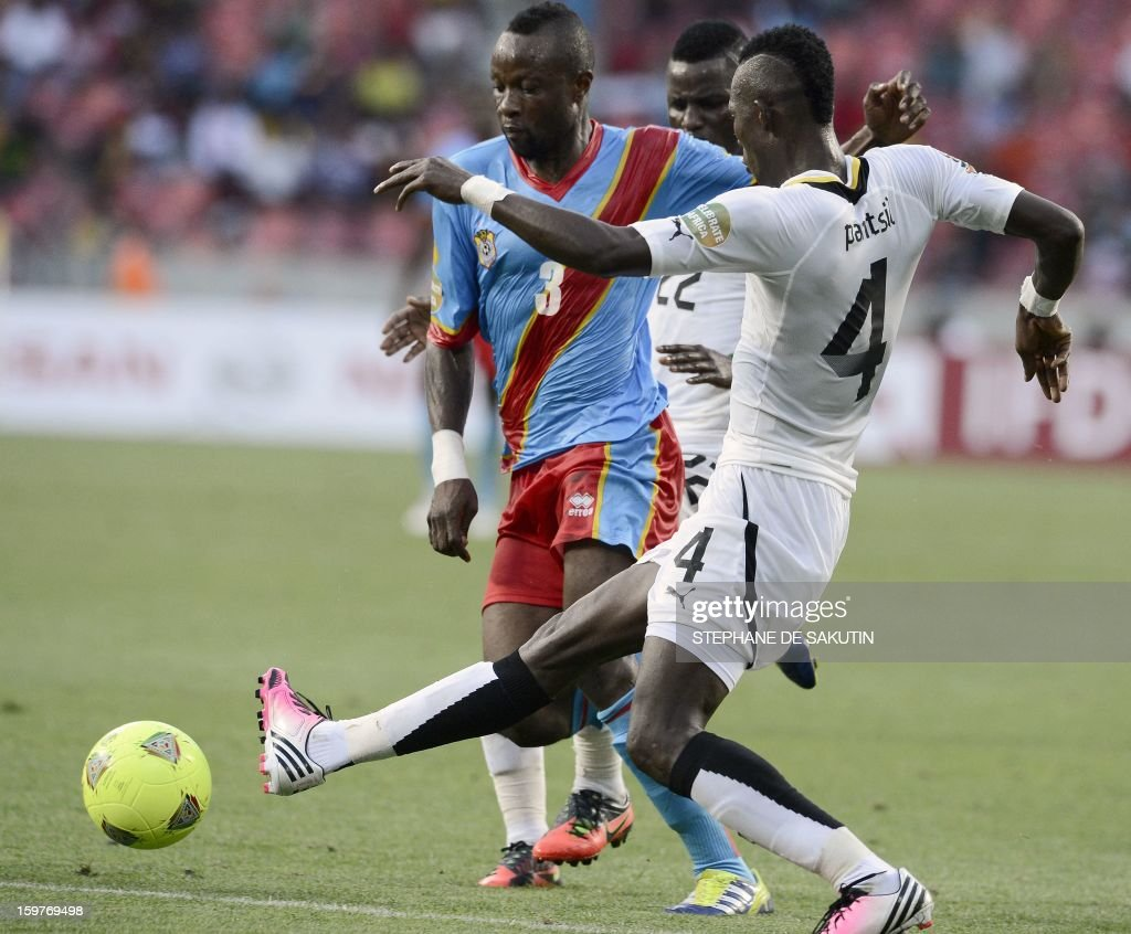 Ghana's defender John Pantsil (R) vies for the ball with Democratic Republic of Congo's defender Jean Kasusula (L) during their 2013 African Cup of Nations football match at the Nelson Mandela Bay Stadium in Port Elizabeth on January 20, 2013.
