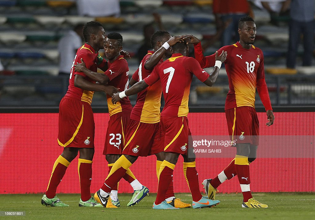 Ghana's football players celebrate after scoring a goal during their friendly match against Egypt in Abu Dhabi on January 10, 2013.