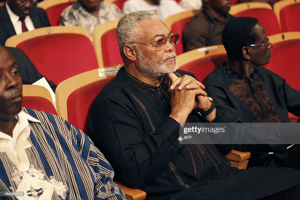 Ghana's former President Jerry John Rawlings (C)attends a ceremony in memory of Ghanaian poet and statesman Kofi Awoonor's on October 11, 2013 in Accra. Mourners paid tribute on October 11 to renowned Ghanaian poet and statesman Kofi Awoonor, who was killed last month in an Islamist attack on a Kenyan mall, at a funeral attended by Ghana's president and other dignitaries. Ghanaian President John Dramani Mahama, former president Jerry John Rawlings and several hundred other mourners attended the funeral at the national theatre hall in Ghana's capital Accra.