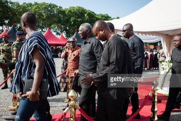 Ghana's former President John Kufuor walks after laying a wreath for Major Maxwell Mahama during state funeral ceremony on June 9 2017 in Accra...