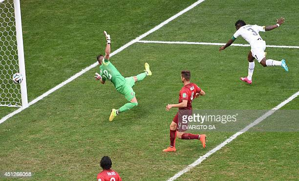 Ghana's forward and captain Asamoah Gyan celebrates after scoring a goal as Portugal's goalkeeper Beto fails to save the ball during the Group G...