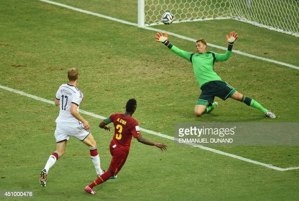 Ghana's forward and captain Asamoah Gyan scores during a Group G football match between Germany and Ghana at the Castelao Stadium in Fortaleza during...