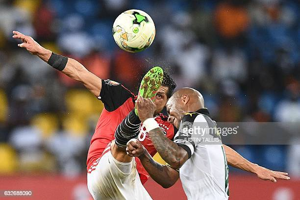 TOPSHOT Ghana's forward Andre Ayew challenges Egypt's midfielder Tarek Hamed during the 2017 Africa Cup of Nations group D football match between...