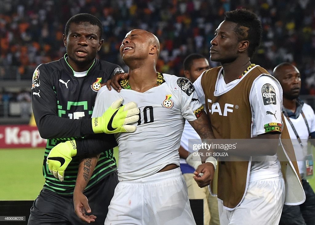 Ghana's forward <a gi-track='captionPersonalityLinkClicked' href=/galleries/search?phrase=Asamoah+Gyan&family=editorial&specificpeople=535782 ng-click='$event.stopPropagation()'>Asamoah Gyan</a> (R) and goalkeeper Fatawu Dauda (L) try to console midfielder Andre Ayew as he cries at the end of the 2015 African Cup of Nations final football match between Ivory Coast and Ghana in Bata on February 8, 2015. Ivory Coast won 9-8 on penalties after the final ended 0-0 following extra time. AFP PHOTO / CARL DE SOUZA