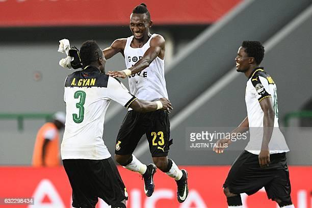 Ghana's forward Asamoah Gyan Ghana's defender Harrison Afful and Ghana's defender Daniel Amartey celebrate at the end of the 2017 Africa Cup of...
