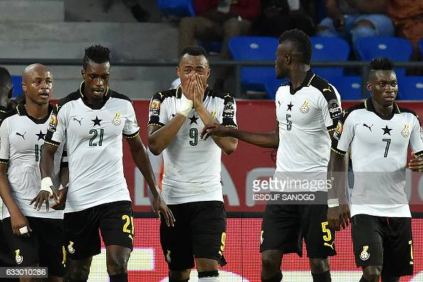 Ghana's forward Jordan Ayew celebrates with teammates after scoring a goal during the 2017 Africa Cup of Nations quarterfinal football match between...