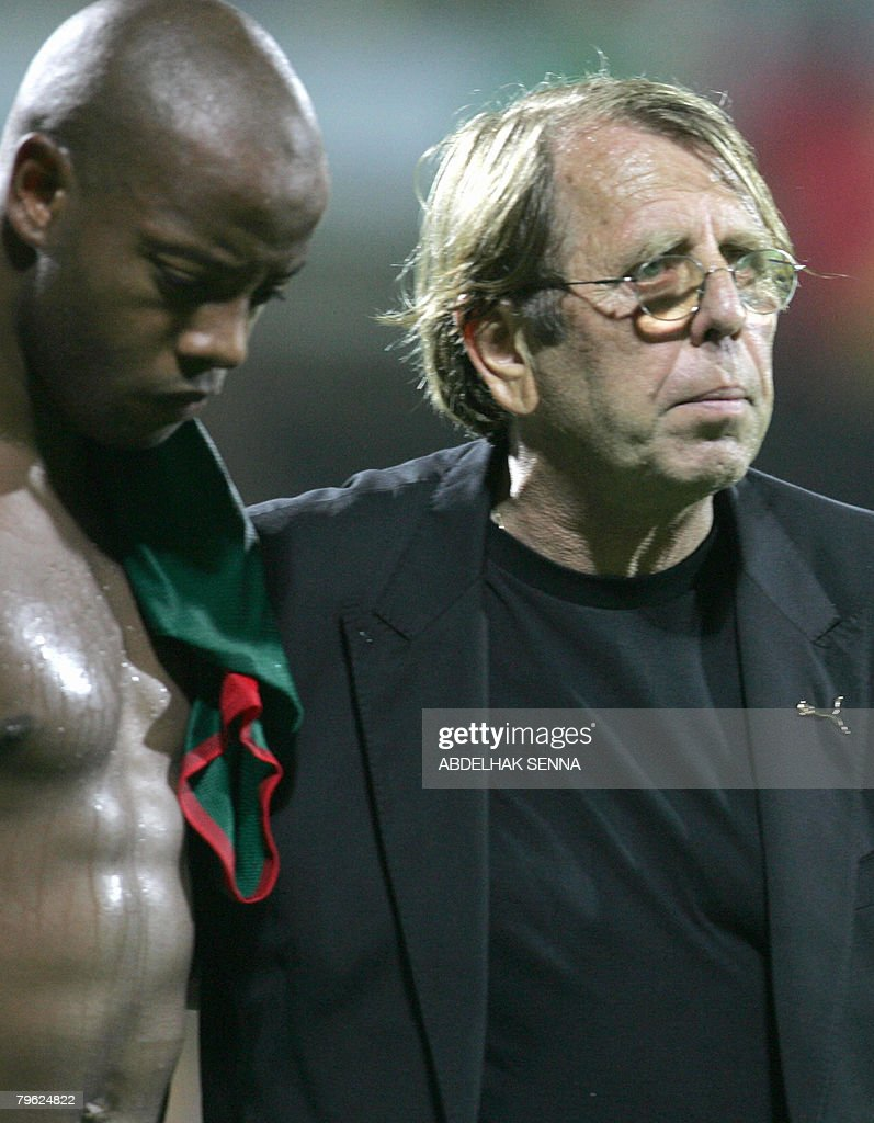 Ghana's French trainer Claude le Roy stands with Ghana's <a gi-track='captionPersonalityLinkClicked' href=/galleries/search?phrase=Junior+Agogo&family=editorial&specificpeople=642315 ng-click='$event.stopPropagation()'>Junior Agogo</a> after Cameroon beat Ghana on February 7, 2008, during the semi-final 2008 African Cup of Nations match in Accra, Ghana. Cameroon won 1-0.