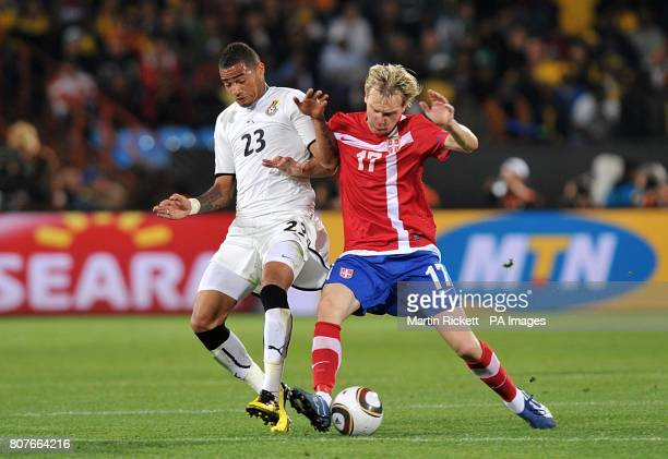 Ghana's KevinPrince Boateng and Serbia's Milos Krasic battle for the ball