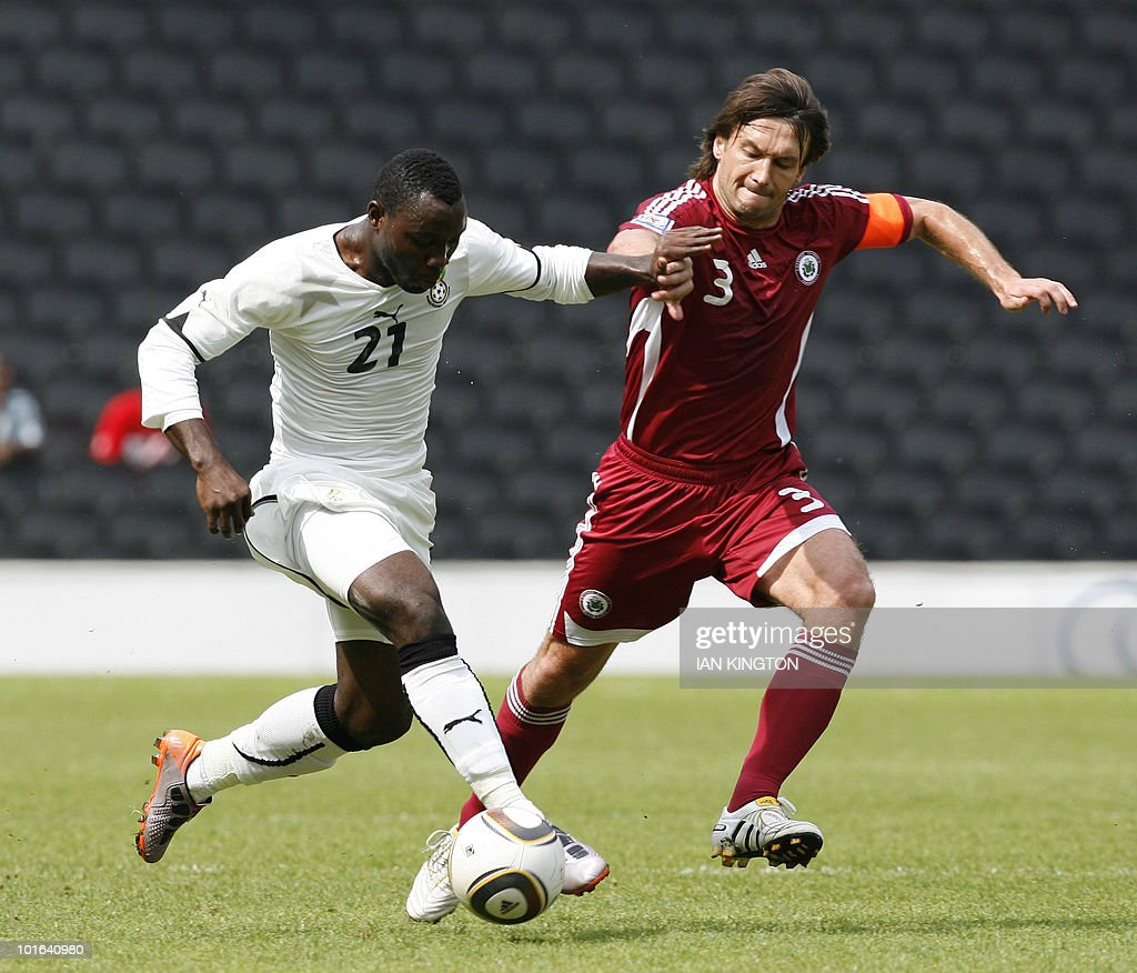 Ghana's Kwadwo Asamoah (L) fights for the ball with Latvia's Vitalijs Astafjevs during a friendly match at the Stadiummk in Milton Keynes, Central England, on June 5, 2010. AFP PHOTO/Ian Kington