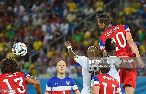 Ghana's midfielder Andre Ayew and US midfielder Jermaine Jones US midfielder Alejandro Bedoya and US defender Geoff Cameron jump for the ball during...