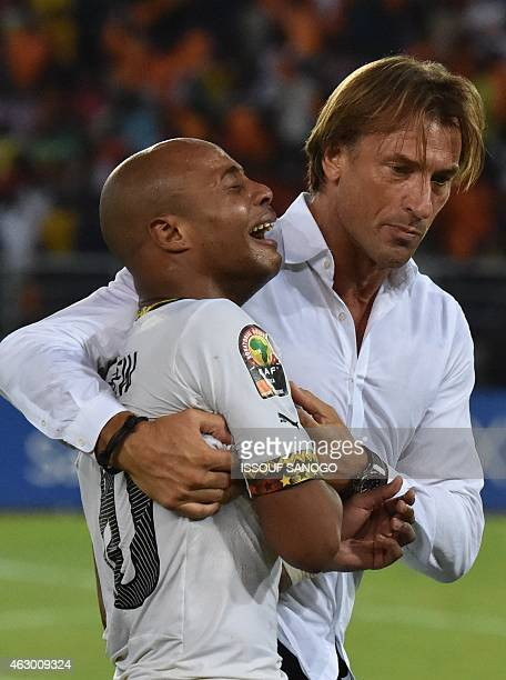 Ghana's midfielder Andre Ayew is comforted by Ivory Coast's coach Herve Renard at the end of the 2015 African Cup of Nations final football match...