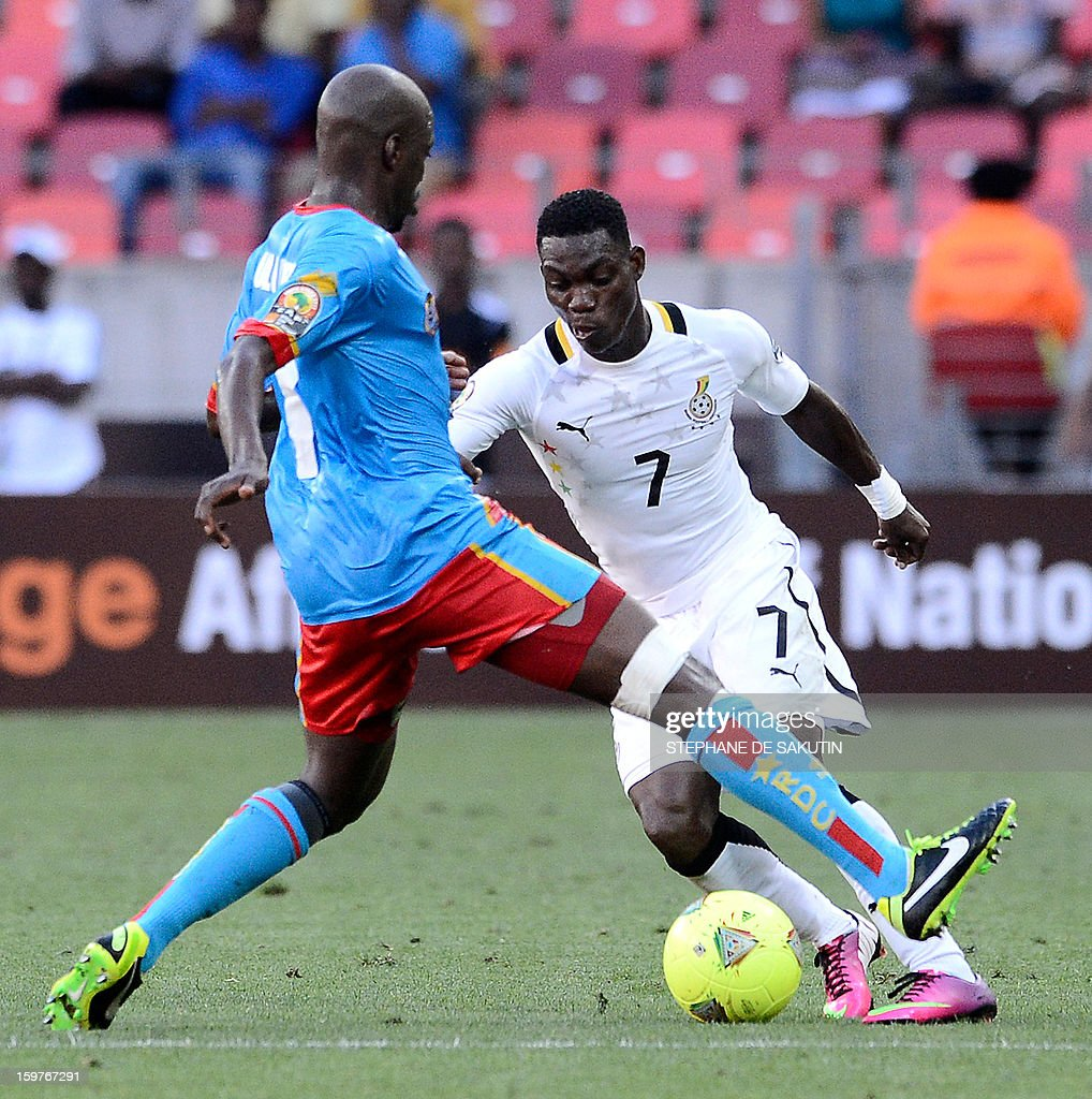 Ghana's midfielder Christian Atsu (R) fights for the ball with Democratic Republic of Congo's midfielder Youssouf Mulumbu (L) during their 2013 Africa Cup of Nations football match at Nelson Mandela Bay Stadium in Port Elizabeth on January 20, 2013.
