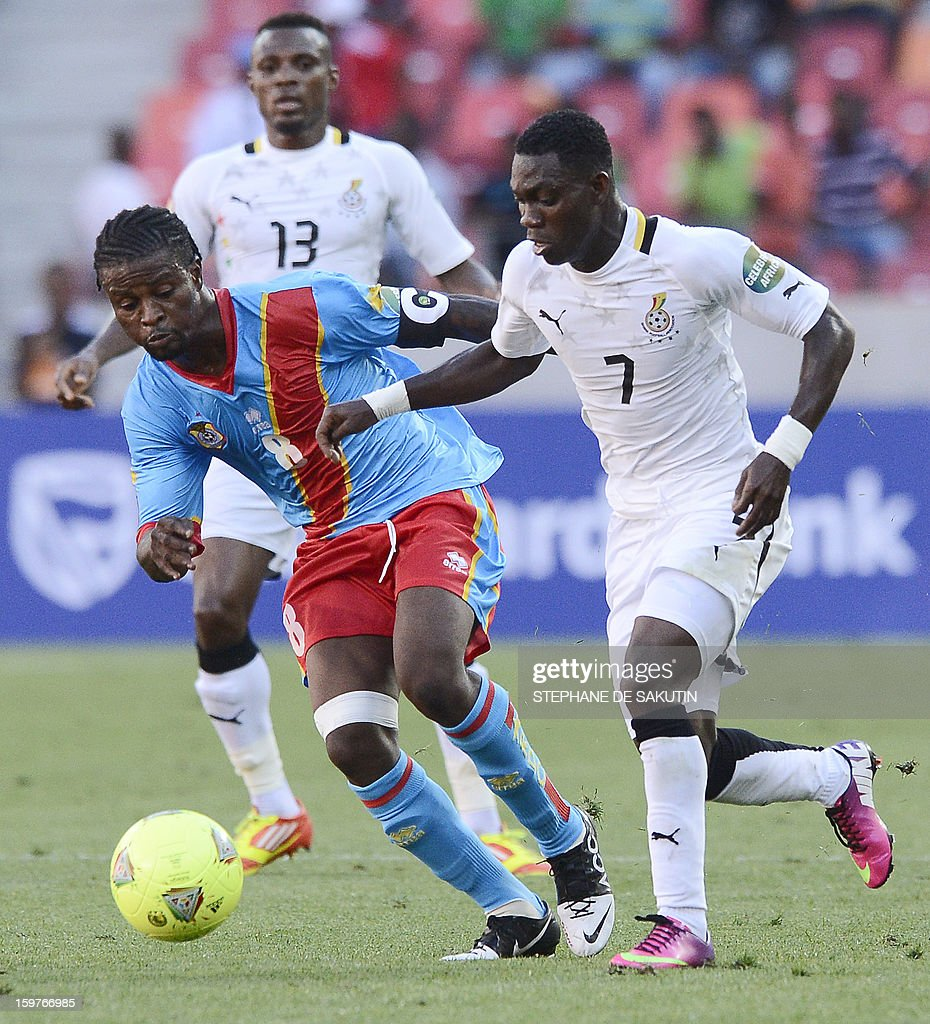 Ghana's midfielder Christian Atsu (R) vies for the ball with Democratic Republic of Congo's midfielder Tresor Mputu during their 2013 African Cup of Nations football match at the Nelson Mandela Bay Stadium in Port Elizabeth on January 20, 2013. AFP PHOTO / STEPHANE DE SAKUTIN