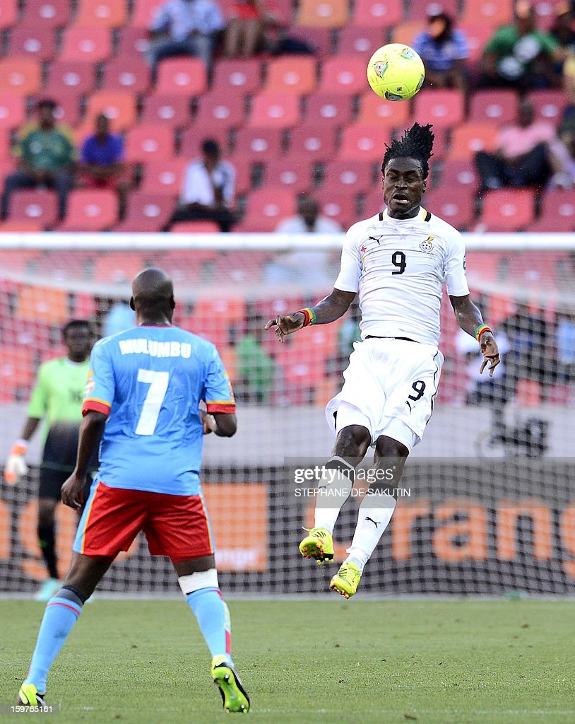 Ghana's midfielder Derek Boateng (R) heads the ball as Democratic Republic of Congo's midfielder Youssouf Mulumbu watches during their 2013 African Cup of Nations football match at the Nelson Mandela Bay Stadium in Port Elizabeth on January 20, 2013.