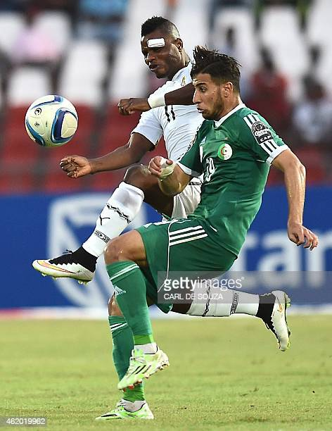 Ghana's midfielder Mubarak Wakaso challenges Algeria's midfielder Saphir Taider during the 2015 African Cup of Nations group C football match between...