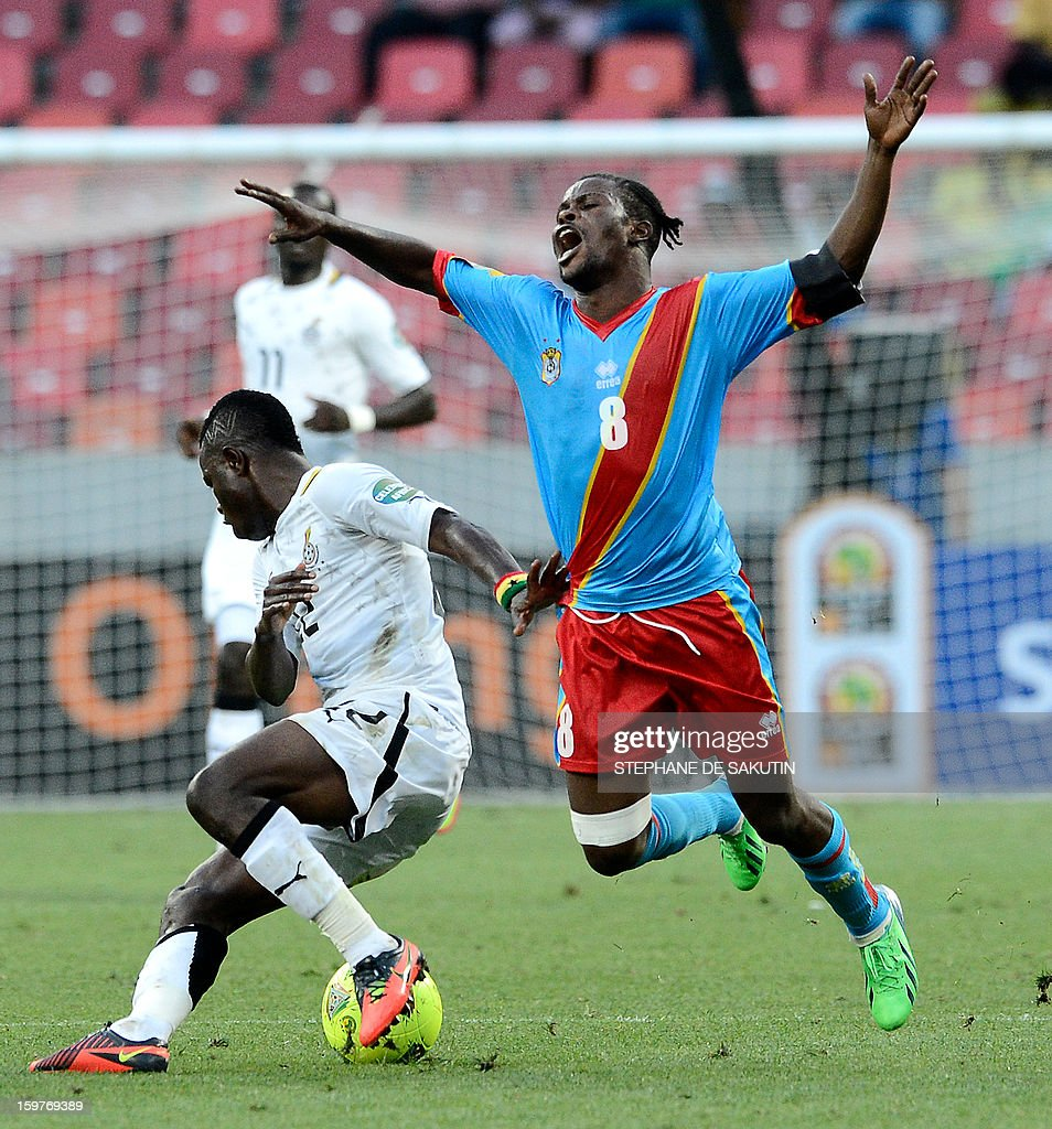 Ghana's midfielder Mubarak Wakaso (L) fights for the ball with Democratic Republic of Congo's midfielderTresor Mputu during their 2013 Africa Cup of Nations football match at Nelson Mandela Bay Stadium in Port Elizabeth on January 20, 2013.