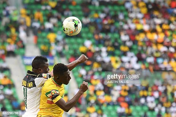 TOPSHOT Ghana's midfielder Mubarak Wakaso heads the ball with Mali's defender Hamari Traore during the 2017 Africa Cup of Nations group D football...