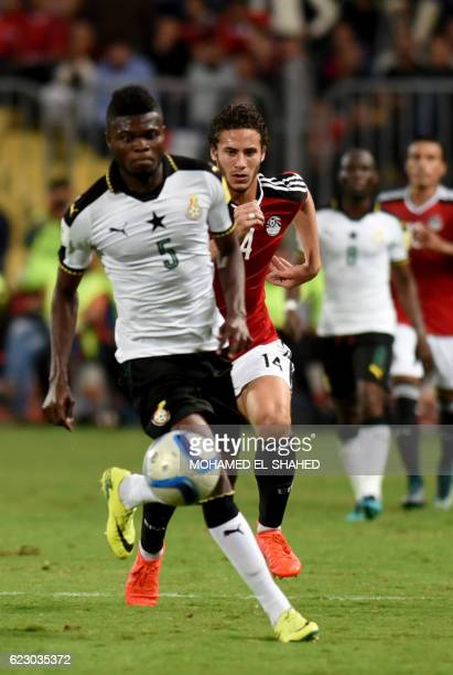 Ghana's Thomas Partey and Egypt's Ramadan Sobhy run for the ball during the 2018 World Cup qualifying Group E football match between Egypt and Ghana...