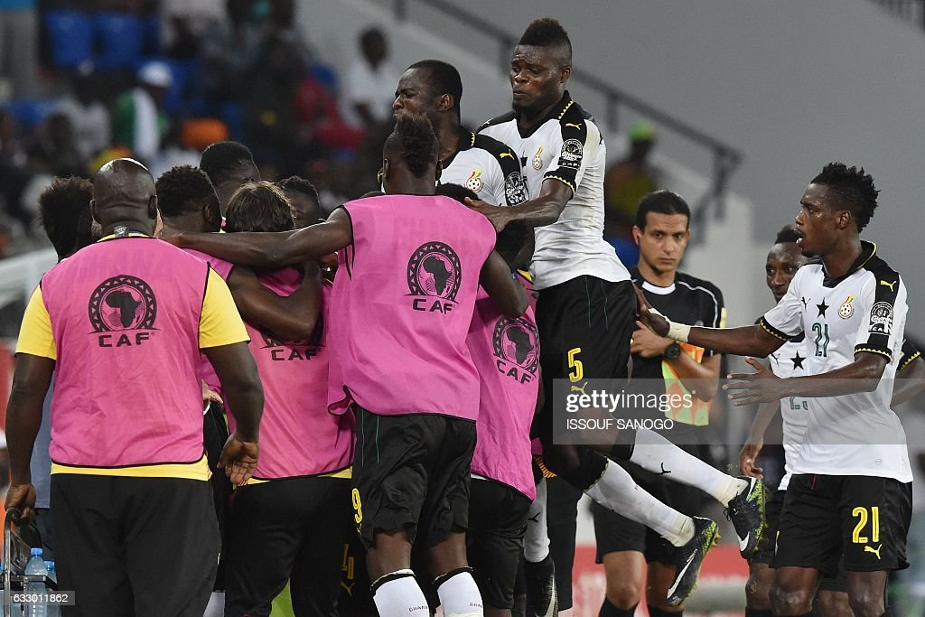 Ghana's players celebrate their second goal during the 2017 Africa Cup of Nations quarter-final football match between DR Congo and Ghana in Oyem on January 29, 2017. / AFP / ISSOUF