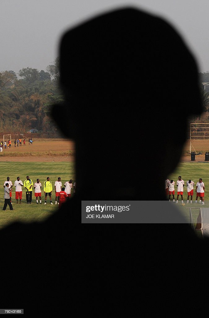 Ghana's policeman is watching Sudan's national football team practice in Kumasi 25 January 2008 during the African Cup of Nations football championship.
