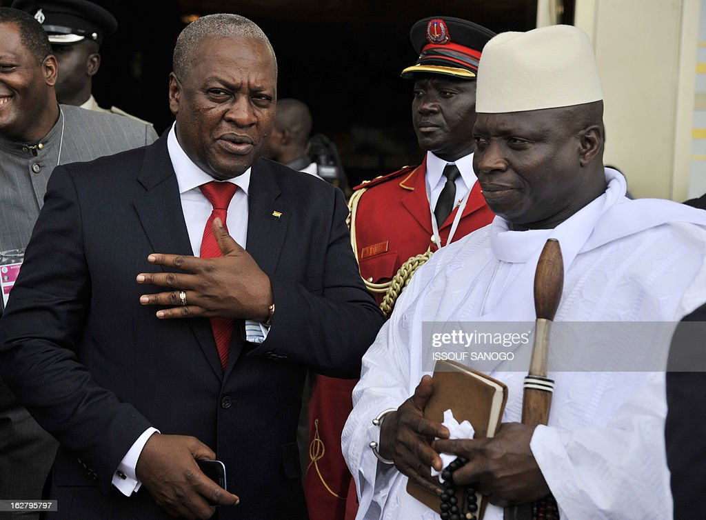 Ghana's President John Dramani Mahama (L) speaks to Gambia's Yahya Jammeh (R) at the Felix Houphouet-Boigny fundation in Yamoussoukro on Febuary 27, 2013 after the opening ceremony of the ECOWAS ordinary summit. West African nations will need aid worth $950 million (715 million euros) to sustain and reinforce a military mission to help fight Islamists in Mali, Ivory Coast's Foreign Minister Charles Koffi Diby said today. AFP PHOTO / ISSOUF SANOGO