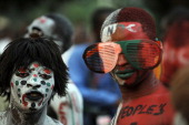 Ghana's ruling National Democratic Congress party supporters with their bodies painted in party colors attend a rally at Kwame Nkrumah Circle in...