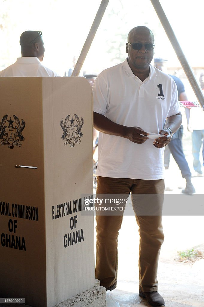 Ghana's ruling National Democratic Congress president and presidential candidate John Dramani Mahama steps out of the polling booth to cast his vote at the Bole polling station in the Bole Bamboi c...