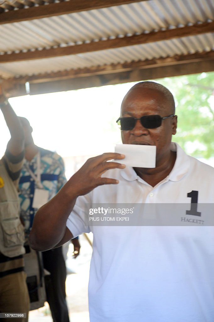 Ghana's ruling National Democratic Congress president and presidential candidate John Dramani Mahama kisses his ballot prior to cast his vote at the Bole polling station in the Bole Bamboi constituency, northern Ghana, on December 7, 2012. Ghana voted in a high-stakes presidential election on December 7 which is expected to be close, with the emerging country seeking to live up to its promise as a beacon of democracy in turbulent West Africa. AFP PHOTO/PIUS UTOMI EKPEI