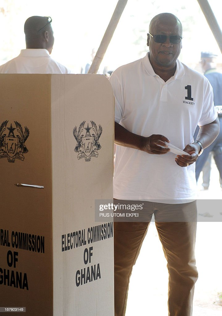 Ghana's ruling National Democratic Congress president and presidential candidate John Dramani Mahama steps out of the polling booth to cast his vote at the Bole polling station in the Bole Bamboi constituency, northern Ghana, on December 7, 2012. Ghana voted in a high-stakes presidential election on December 7 which is expected to be close, with the emerging country seeking to live up to its promise as a beacon of democracy in turbulent West Africa. AFP PHOTO/PIUS UTOMI EKPEI