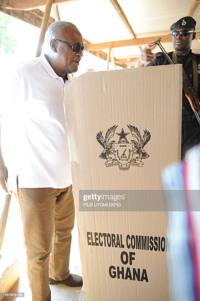 Ghana's ruling National Democratic Congress president and presidential candidate John Dramani Mahama arrives to cast his vote at the Bole polling station in the Bole Bamboi constituency, northern Ghana, on December 7, 2012. Ghana voted in a high-stakes presidential election on December 7 which is expected to be close, with the emerging country seeking to live up to its promise as a beacon of democracy in turbulent West Africa.