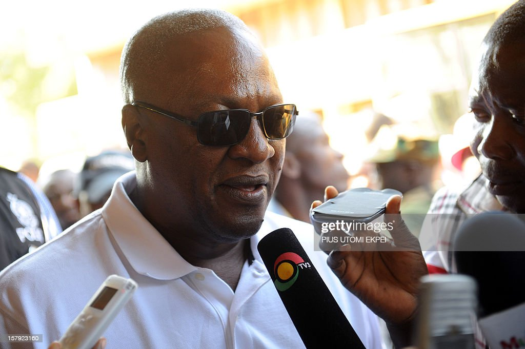 Ghana's ruling National Democratic Congress president and presidential candidate John Dramani Mahama talks to the press after casting his vote at the Bole polling station in the Bole Bamboi constituency, northern Ghana, on December 7, 2012. Ghana voted in a high-stakes presidential election on December 7 which is expected to be close, with the emerging country seeking to live up to its promise as a beacon of democracy in turbulent West Africa. AFP PHOTO/PIUS UTOMI EKPEI
