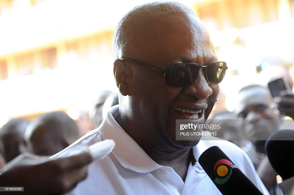 Ghana's ruling National Democratic Congress president and presidential candidate John Dramani Mahama smiles while talking to the press after casting his vote at the Bole polling station in the Bole Bamboi constituency, northern Ghana, on December 7, 2012. Ghana voted in a high-stakes presidential election on December 7 which is expected to be close, with the emerging country seeking to live up to its promise as a beacon of democracy in turbulent West Africa. AFP PHOTO/PIUS UTOMI EKPEI
