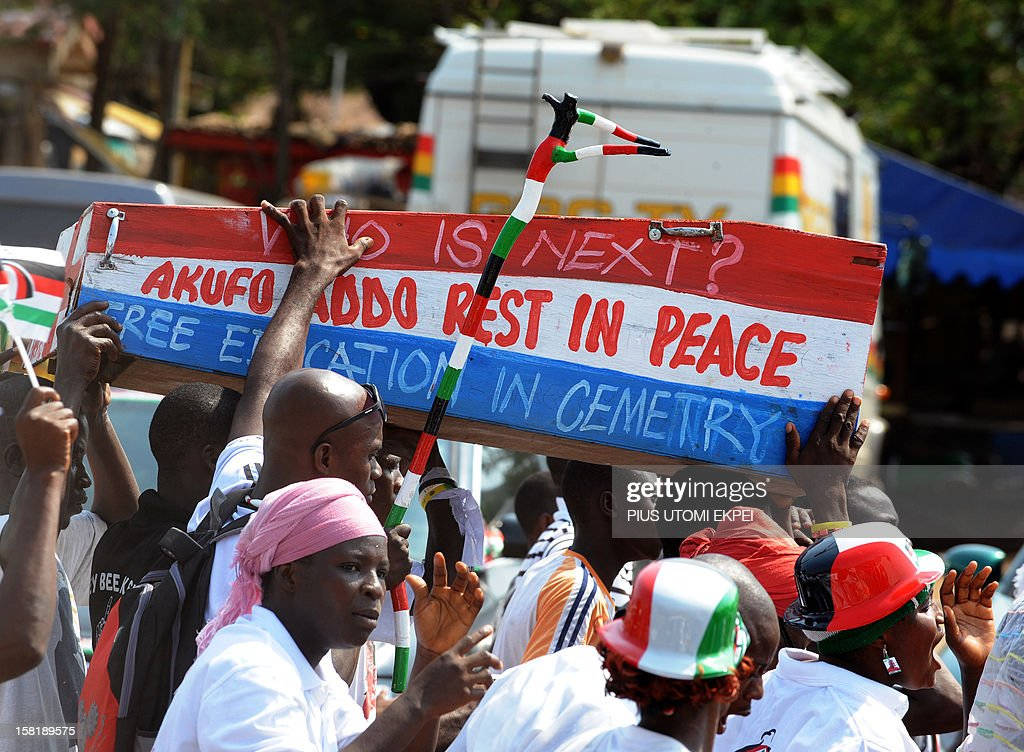 Ghana's ruling National Democratic Congress supporters carry a mock coffin to spite candidate of the opposition New National Patriotic Party as they...