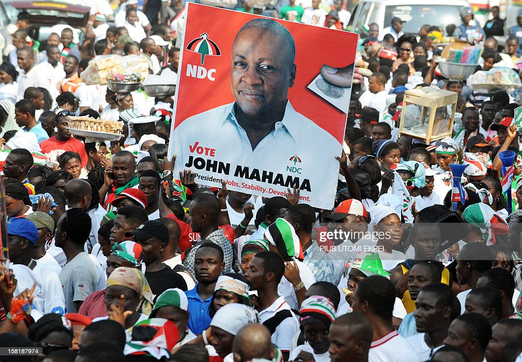 Ghana's ruling National Democratic Congress supporters carry a picture of reelected Ghanaian President John Dramani Mahama during a mandate...