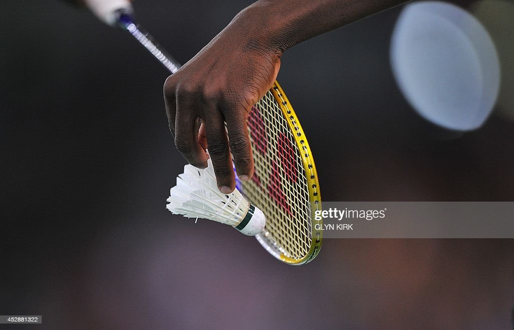 Ghana's Sam Daniel serves during a Badminton Men's singles match against Aatish Lubah of Mauritius at the Emirates Arena during the 2014 Commonwealth...