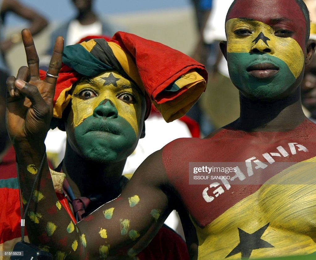 Ghana's soccer team fans pose for photographer 21 January 2002 during the 2002 African Nations Cup match Ghana vs Morocco in Segou The match ended in...