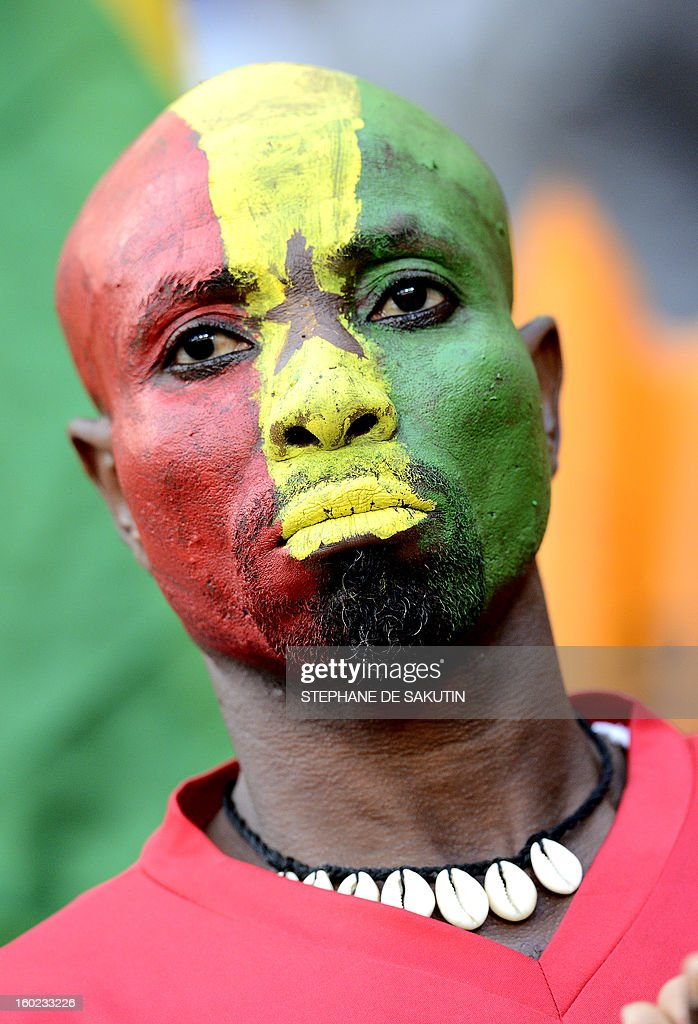 A Ghana's supporter as his face painted with Ghana's colors prior a 2013 Africa Cup of Nations football match against Niger at Nelson Mandela Bay Stadium in Port Elizabeth on January 28, 2013.