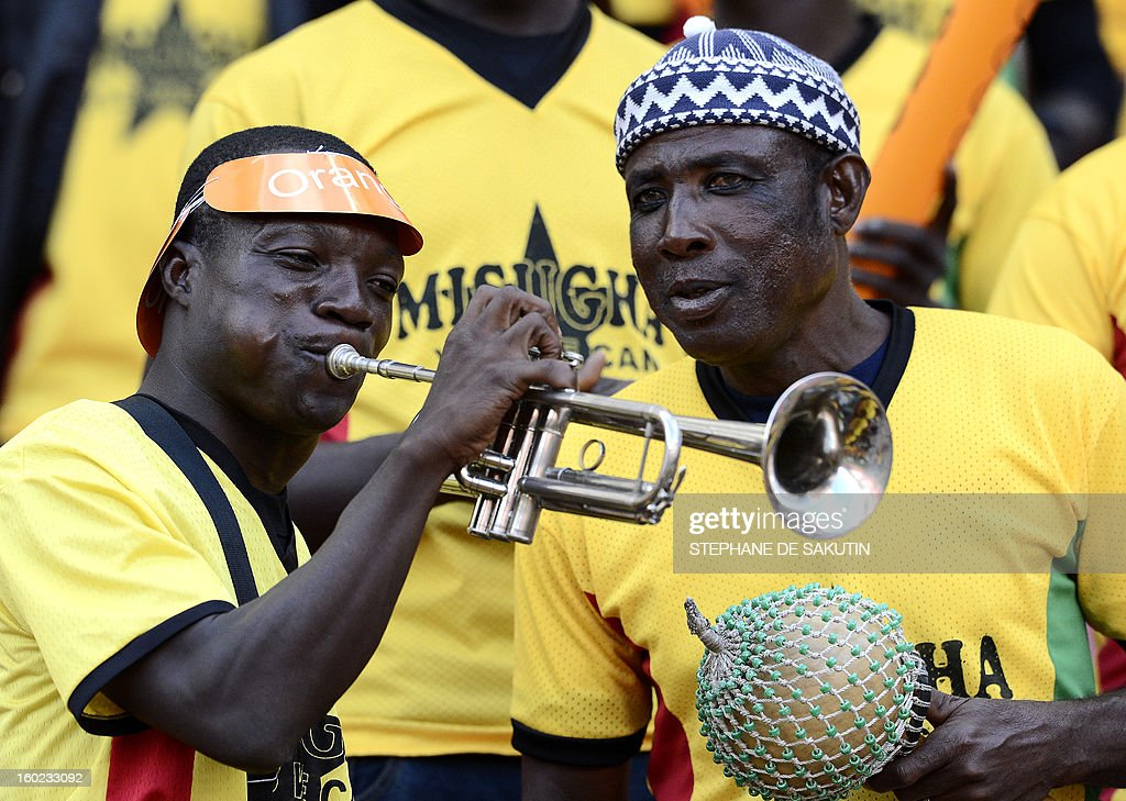 A Ghana's supporter plays the trumpet prior a 2013 Africa Cup of Nations football match against Niger at Nelson Mandela Bay Stadium in Port Elizabeth on January 28, 2013. AFP PHOTO / STEPHANE DE SAKUTIN
