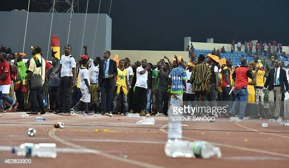 Ghana's supporters try to get out of the stadium at the end of the 2015 African Cup of Nations semifinal football match between Equatorial Guinea and...