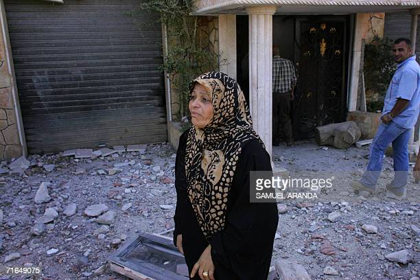 A woman cries outside her damaged flat in the southern Lebanese village of Ghanduriyeh 15 August 2006 The village was in Israeli hands until early...